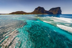 Aerial view of Lord Howe Island Coastline and Mt Gower background, turquoise blue Coral reef, Lord Howe Island is World Heritage Listed,situated in the Tasman Sea, between Australia and New Zealand