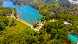 Aerial view of Love Valley park in Dalat, Vietnam is one of the most romantic sites of Da Lat city, with many deep valleys and endless pine forests. Travel concept.