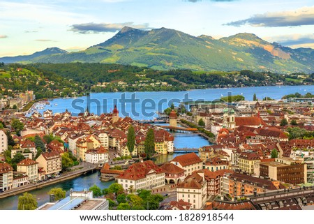 Aerial view of Lucerne skyline and lake Lucerne with Mount Rigi and its peak Rigi-Kulm in the Canton of Lucerne, Switzerland. Amazing panorama with sunset orange clouds and green hills. Stock fotó ©