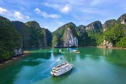 Aerial view of Luon cave and rock island, Halong Bay, Vietnam, Southeast Asia. UNESCO World Heritage Site. Junk boat cruise to Ha Long Bay. Popular landmark, famous destination of Vietnam