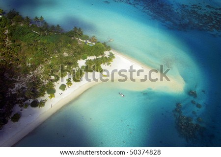 Aerial View of luxurious beach at Bora Bora, in the pacific Ocean.
