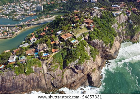 Aerial view of luxury homes perched on a cliffside in Rio De Janeiro