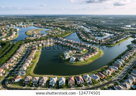 aerial view of luxury suburban home community in south florida