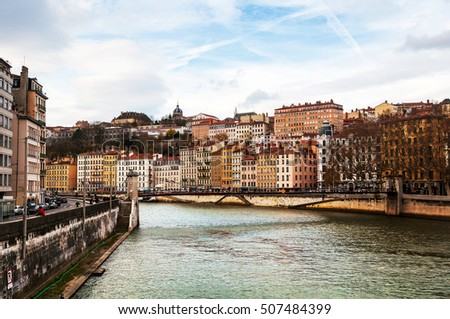 Aerial view of Lyon in autumn with River and Bridge, France. Historical buildings with cloudy blue sky #507484399