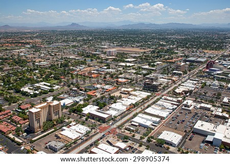 Shutterstock Aerial view of Main Street in downtown Mesa, Arizona with light rail transportation near completion