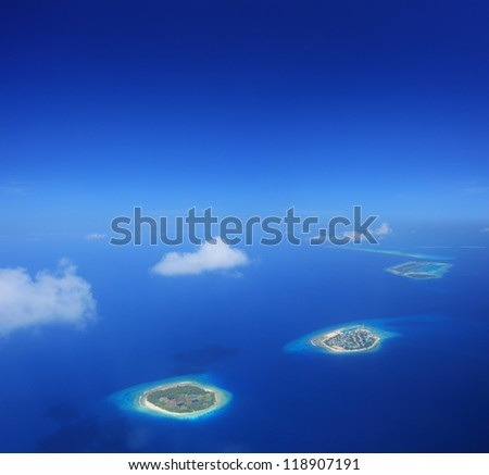 Aerial view of Maldives islands in Indian ocean, shot with a tilt and shift lens - stock photo