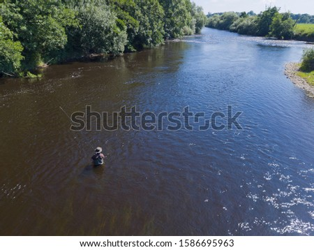 Aerial View Of Man Coarse Fishing In River Wye