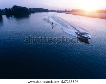 aerial view of man wakeboarding ...