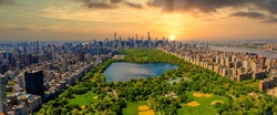 Aerial view of Manhattan New York looking south up Central Park during epic sunset over the city.