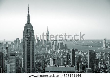 Aerial view of Manhattan skyline at sunrise, New York City, USA. Black and white style image