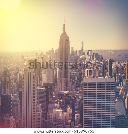 Aerial view of Manhattan skyline at sunrise, New York City, USA. Vintage style image