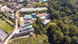 aerial view of many colorful houses beside pine forest at Dalat city, Vietnam