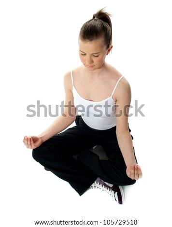 aerial view of meditating girl in lotus pose stock photo