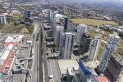Aerial view of Mexico City over main part of Santa Fe modern district with many financial and corporate buildings