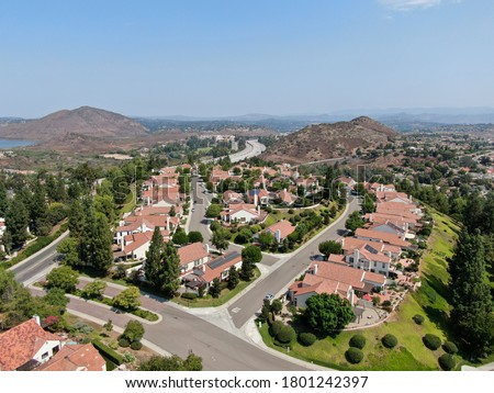 Aerial view of middle class neighborhood with residential house community and mountain on the background in Rancho Bernardo, South California, USA. Сток-фото ©
