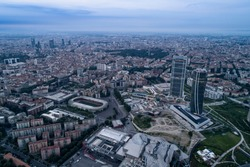 Aerial view of Milan (Italy) at dawn. On the right the new two skyscrapers of the CityLife district and the building site of the third tower.