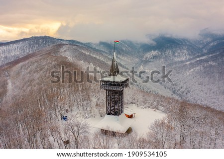 Aerial view of Millennium Lookout Tower which can be reach by foot from Szalajka-Valley near Szilvásvárad, Heves, Hungary. Winter landscape with cloudy sky. Stock fotó ©