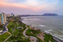 Aerial view of Miraflores Malecon park by the ocean in Lima, Peru. People, tourists and cyclists having fun in