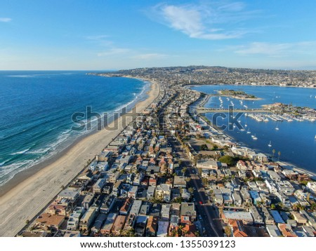 Aerial view of Mission Bay & Beaches in San Diego, California. USA. Community built on a sandbar with villas, sea port.  & recreational Mission Bay Park. Californian beach-lifestyle.