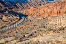 aerial view of Moab Fault with highway, bike trail, railroad, visitor center and entry to Arches National Park near Moab, Utah