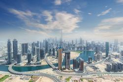 Aerial view of modern city skyscrapers in Dubai, United Arab Emirates.