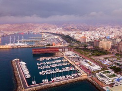 Aerial view of modern cityscape and harbour of Spanish city of Almeria in cloudy spring evening