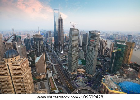 aerial view of modern metropolis in shanghai at dusk