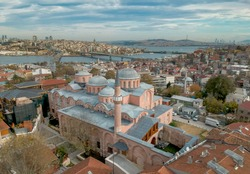 Aerial view of Molla Zeyrek Mosque in Istanbul Turkey with Galata Tower and Golden Horn on the horizon
