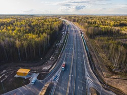Aerial view of Moscow - Saint Petersburg motorway toll road, Russian federal highway in the European part of Russia, parallel to the M10 highway, from the federal cities of Moscow to St. Petersburg.