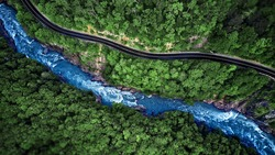 Aerial view of Mountain river and road. Mountain gorge. nature, top view.