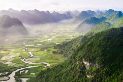 Aerial view of multiple mountain peaks and rice field in Vietnam