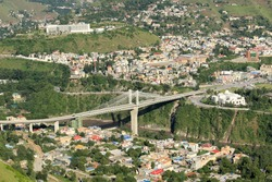 Aerial view of Muzaffarabad City the  largest city of the Pakistani-administered territory of Azad Jammu and Kashmir with Earthquake Memorial Bridge.