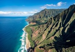 Aerial view of Na Pali coastline and Kalalau beach on hawaiian island of Kauai from helicopter flight