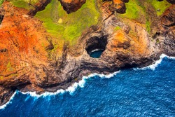 Aerial view of Na Pali coastline open ceiling cave from helicopter, Kauai, Hawaii, USA