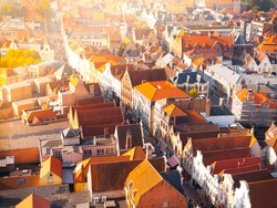 Aerial view of narrow streets and red rooftops of Bruges, Belgium