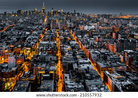 Aerial view of New York City at night with illuminated avenues converging towards midtown. #210557932