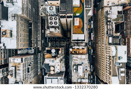 Aerial view of New York downtown building roofs with water towers. Bird's eye view from helicopter of cityscape metropolis infrastructure, traffic cars moving on city streets and district avenues #1332370280