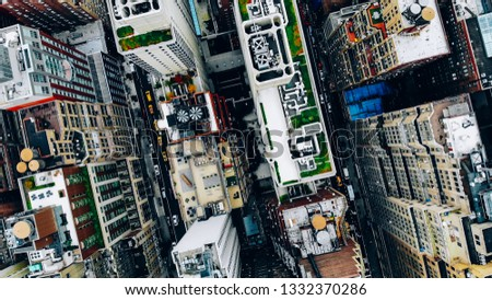 Aerial view of New York downtown building roofs with water towers. Bird's eye view from helicopter of cityscape metropolis infrastructure, traffic cars moving on city streets and district avenues #1332370286