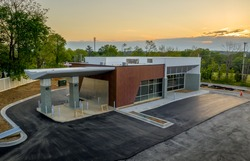 Aerial view of newly constructed bank branch commercial real estate building with drive through ATM lanes