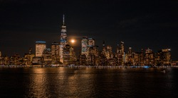 Aerial view of NewYork City and downtown skyline from Hudson River at night