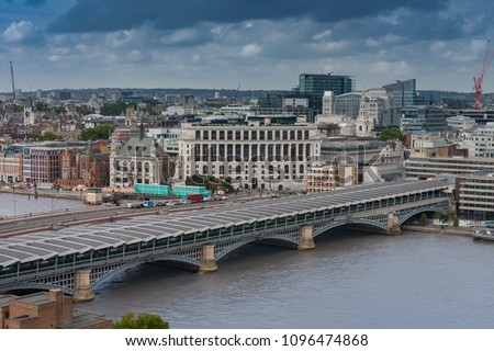 Aerial view of north  bank of the river Thames, Blackfriars Railway Bridge  in London.