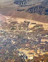 Aerial view of North Las Vegas city in Nevada United States of America scenery with castle rock hills airport roads residential urban blocks detail exterior satellite landmark