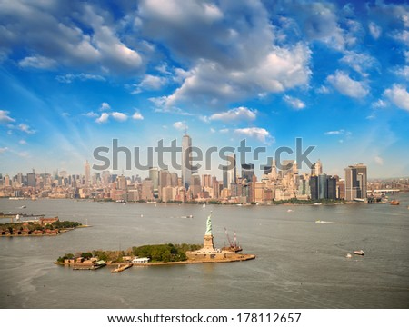 Aerial view of NYC. Statue of Liberty with Manhattan skyline.