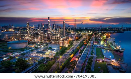 Aerial view of Oil and gas industry - refinery, Shot from drone of Oil refinery and Petrochemical plant  at twilight, Bangkok, Thailand #704193385