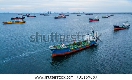 Aerial view of oil tanker ship loading in port.