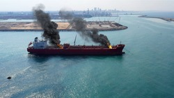 Aerial view of Oil Tanker Ship on fire with smoke in the emiddle east
