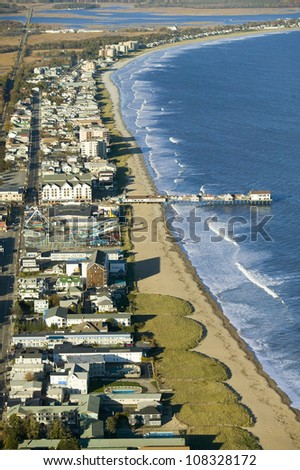 Aerial view of Old Orchard Beach downtown, pier, new hotel and amusement park on Maine Coastline south of Portland