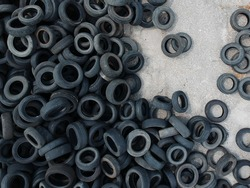 Aerial view of old tires. Many car and truck tires on dump site from above. Aerial view. Drone photo.