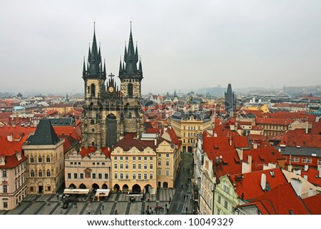 aerial view of Old Town Square neighborhood in Prague from the top of the town hall - stock photo