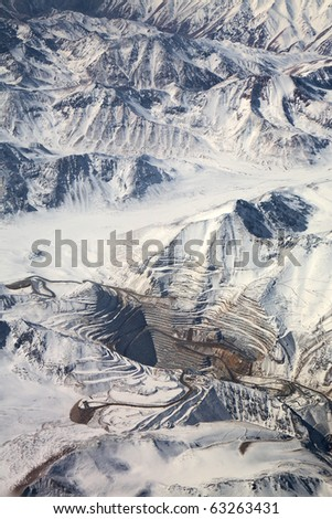 aerial view of open-pit mine under snow in Atacama desert, Chile